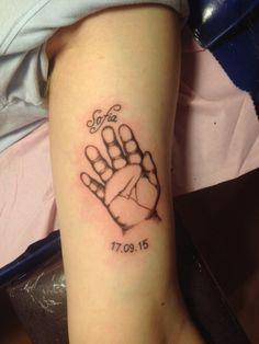 Baby's hand print tattoo
