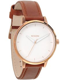 A genuine brown leather band accents the rose gold stainless steel case and offers 50 meter water resistance for a durable watch that lasts.