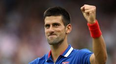 Novak Djokovic of Serbia celebrates after defeating Andy Roddick of the United States during the second round of Men's Singles Tennis on Day 4 of the London 2012 Olympic Games at Wimbledon