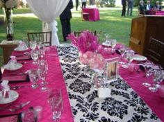 hot pink under the runner, with black chargers black n white damask plates and hotpink dessert plates