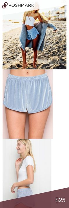 """NWT Baby Blue Velvet Lisette Shorts Super soft velvet-feel pull-on shorts in pastel blue  with binding along the side seams and hemline, elasticized waistband and full silky lining inside.      90% nylon, 10% spandex     8.5"""" rise, 2"""" inseam, 11.5 waist (stretch)     MODEL is 5'8"""" with a 24"""" waist.     Made In Italy     Color: Blue Brandy Melville Shorts"""