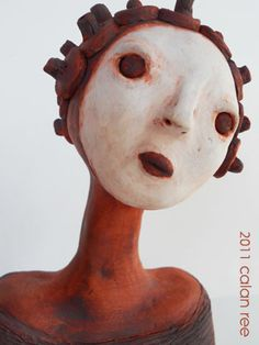 Experimenting using iron oxide on a low fire on this clay bust combined with some white underglaze.