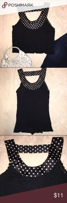 Black tank with polka dot neckline Black tank with polka dot neckline. Features strap across the back. Forever 21 size small. 94% viscose 6% spandex. Forever 21 Tops Tank Tops
