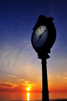 Boardwalk clock at sunrise: Bethany Beach DE by Frank Blanchard, via Flickr