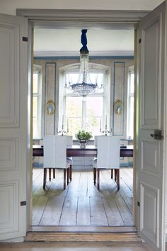 """Swedish Interiors by Eleish van Breems """"Tailored white slipcovers bring an exquisite  1770s Swedish dining room down to earth."""""""
