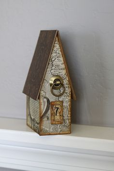 Map birdhouse. I love birdhouses AND maps. Perfection.