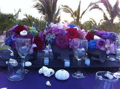 Molcajete centerpiece with colorful flowers!! Los Cabos Wedding Decor