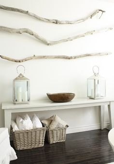 drift wood accents... Do this over bed, paint the sticks and hang beads from them