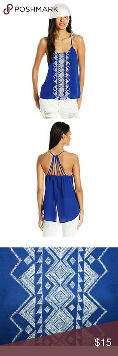 Embroidered Cobalt High-Low Top NWT This high-low, rich blue top has beautiful geometric embroidery in white thread on the front. It has a split back and adjustable strappy detail on the back. It is light and sexy! XL is a junior size, so remember it's probably more like a L in womens. Fabric is 100% polyester. My Michelle Tops Tank Tops