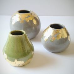 gray and gold spherical bud vase. $30.00, via Etsy.