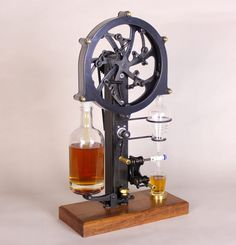 An Ingenious Hand-Cranked Device That Releases the Right Amount of Alcohol to Fill a Shot Glass