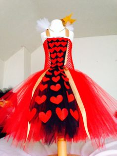 Absolutely gorgeous queen of hearts tutu dress handcrafted using a vibrant red and contrasting black tulle skirt, decorated with beautiful red