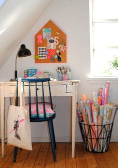 Great storage idea for wrapping paper and just a great overall design of a work area.