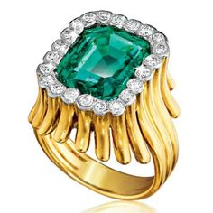Verdura Flutes Ring 14k yellow gold mounting set with 7.30 carat emerald-cut Colombian emerald and 22 round diamonds weighing approximately 1.60 carats.