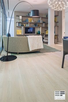 Light color engineered wood floor: Bianco Perla. A selection of Soho and Terra Collection colours is used in the YONGE + RICH Condominium located in downtown Toronto.    The Soho Collection offers a wide range of chic, stained and oil finished European Ash & Oak wood decors. The square edge planks provide clean lines and the real wood top layer offers the quality and warmth of real wood.  Available is store! Visit our showroom: 1310 Castlefield Ave, Toronto