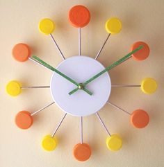 "Juicy Clock Pop: Made of recycled caps. 11""dia. $25 #Clock #Pop_Top"