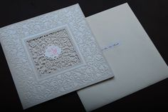 Intricate laser-cut designs add drama to invitations. - From Grace & Man's wedding