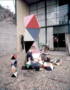 A boy and girl play with a construction toy designed by Ray and Charles Eames 1950 It consisted of plasticcoated paper dowel rods and connecters