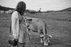 the girl and the cow by Ruben Whitestone