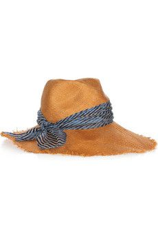3b9d38d688508 Top off a chic summer wardrobe with Eugenia Kim s stylish straw sunhat.  Trimmed with a