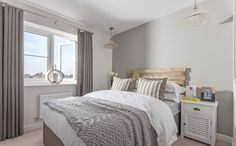 Interior Designed Guest Bedroom / Contemporary masculine bedroom. Pale grey, elephant's breath, textured linen, drift wood... this is a good example of one colour decorating, but using tonnes of texture to break it up. Well done Bellway Homes, your 2015 photographs are much sharper than last years!