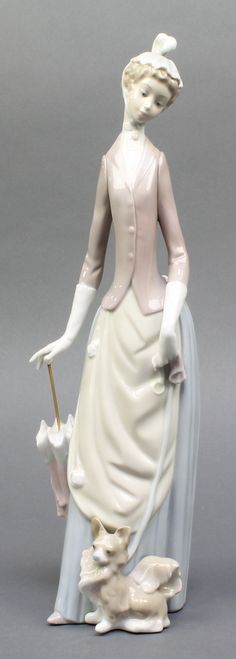 "Lot 101, A Lladro figure of a lady with parasol and dog 14"", boxed, est £50-75"