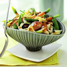 Fettuccine, ginger, and sugar snap peas come together with chicken, carrots, and dried mushrooms for a satisfying meal that delivers on taste and nutrition.