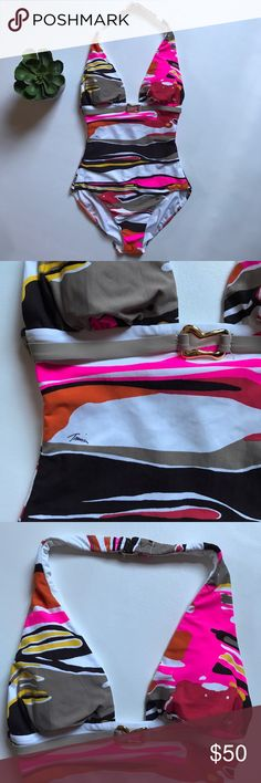 Trina Turk One Piece Swimsuit This size S Trina Turk swimsuit is in overall good used condition.  Very light fading and there two small holes near the seam where it was incorrectly tagged.  (Pictured.)  Decorative belt.  Built in bra.  Bust flat 11, but it stretches.  Self 84 nylon, 16 spandex.  Lining 91 polyester 9 Lycra.  Lining 100 nylon.  From a smoke free, pet friendly home. Trina Turk Swim One Pieces