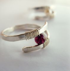 Garnet Ring Hammered Sterling Silver - Modern Contemporary Ring - Wire Wrapped Garnet Ring. $32.00, via Etsy.