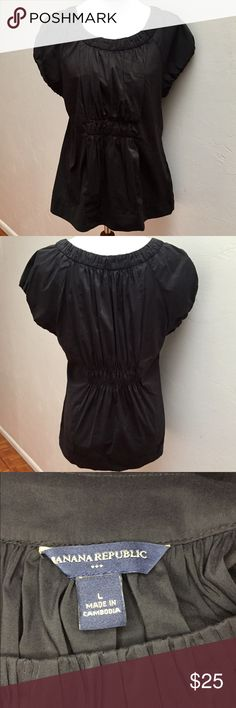 """Banana Republic Black Smocked Short Sleeve Top This top is in excellent condition!! It's smocked around the neck, middle of the torso, middle of the back, and at the arm openings. The smocked areas that stretch are the middle of the back and arm openings.  Approximate measurements: Total length - 25"""" Armpit to armpit - 18 1/2"""" Sleeve length - 4 1/2""""  🚫Sorry, no trades or modeling🚫  SS1069 Banana Republic Tops Blouses"""
