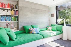 Daybeds along length of wall