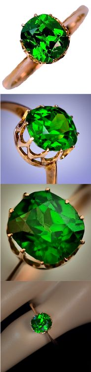 Exceptional antique Russian demantoid garnet ring, circa 1910. A rose gold ring is set with an exceptional antique cushion cut Russian Uralian demantoid garnet. The demantoid has a beautiful emerald green color and is filled with fire. Via 1stdibs.