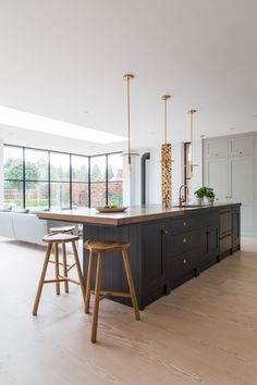 London-based Kinnersley Kent Design mixes wood counter top with stone around sin… - Kitchen - Best Kitchen Decor! Open Plan Kitchen Living Room, Home Decor Kitchen, My Living Room, Interior Design Kitchen, New Kitchen, Home Kitchens, Interior Livingroom, Interior Plants, Green Kitchen