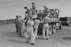 US Army nurses disembarking from a truck on their way to planes for transport after they were liberated from Japanese internment camps during WWII. Manila, Luzon, Philippine Islands