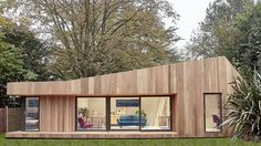 This prefabricated garden studio in suburban London combining guest accommodation with a home office is clad with sustainable cedar wood