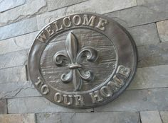 French Fleur De Lis Welcome to our Home Plaque  / Louisiana / New Orleans / Oil Rubbed Bronze. $28.50, via Etsy.