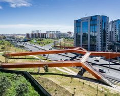 maximina almeida + telmo cruz overlap orange steel bridge above highway in lisbon Bridges Architecture, Landscape Architecture, Architecture Design, Landscape Plans, Urban Landscape, Landscape Design, Bridge Structure, Steel Bridge, Urban Design Diagram