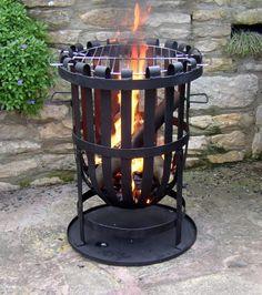 "Not a Grill, Not a Fire Pit, a ""Fire Basket"" « Luxury Housing Trends Garden Fire Pit, Diy Fire Pit, Fire Pit Backyard, Metal Fire Pit, Concrete Fire Pits, Fire Pit Plans, Fire Pit Swings, Fire Basket, Outdoor Fireplace Designs"