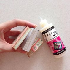 Starting from one end, glue the pattern paper onto the matchbox using glossy accent or any fine tip glue...