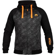 "<h3 class=""block__title"">VENUM TRAMO HOODY - BLACK/GREY</h3> Stay warm and comfortable before and after training, with the <strong>Venum Tramo Hoodie</strong>!  This <strong>Venum Hoodie</strong> will keep you warm thanks to its brushed interior which provides insulation and optimal conservation of body heat.  Its adjustable hood adds comfort and additional protection against the wind and weather. <h3 class=""block__title"">weighing you down.</h3> Its fabric has a water-repellent treatm..."