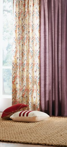 Golden hues, plums and deep reds are perfect for the season. Add texture with curtains and pillows. HomeDecorators.com