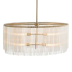 Material: Plated Steel/Glass Finish: Brass/Amber Number of Lamps: 4 Socket Type: Type A - E26 Bulb Type: A19 Incandescent  The antique brass plating and uneven ribbed amber glass rods lend a transitional feel to this modern design. The four lights provide plenty of light when hanging over a rectangle dining table. Shown with radio bulbs.