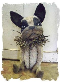 whimsical rendition of the early 1900's antique papier mache french bulldog pull toys.