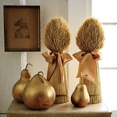 Go for Gold | Painted gourds and wheat sheaves are a perfect touch for any Thanksgiving table.
