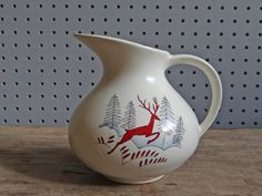 Vintage milk jug with a winter scene of stag/reindeer in Nordic scenery. From the 'Stockholm' range produced by Crown Devon Pottery in the 1950s | H is for Home http://hisforhome.com/shop