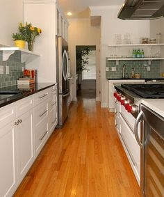 Glass Tile Backsplash White Cabinets Black Countertop Design Ideas, Pictures, Remodel, and Decor - page 2