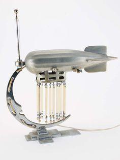 Lot:Art Deco Zeppelin Lamp, Lot Number:338, Starting Bid:$200, Auctioneer:Noel…