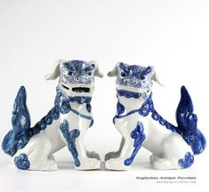 Pair of Chinese mythology ceramic dog statues in cobalt blue color