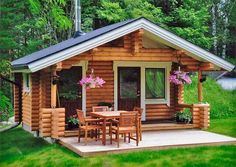 No photo description available. Modern Wooden House, Wooden House Design, Bamboo House Design, Small House Design, Hut House, Tiny House Cabin, Tiny House Plans, Small Cottage Homes, Cabins And Cottages