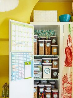 this pantry is small but she makes the most of it with clear containers. LOVE the meal planning on the door!